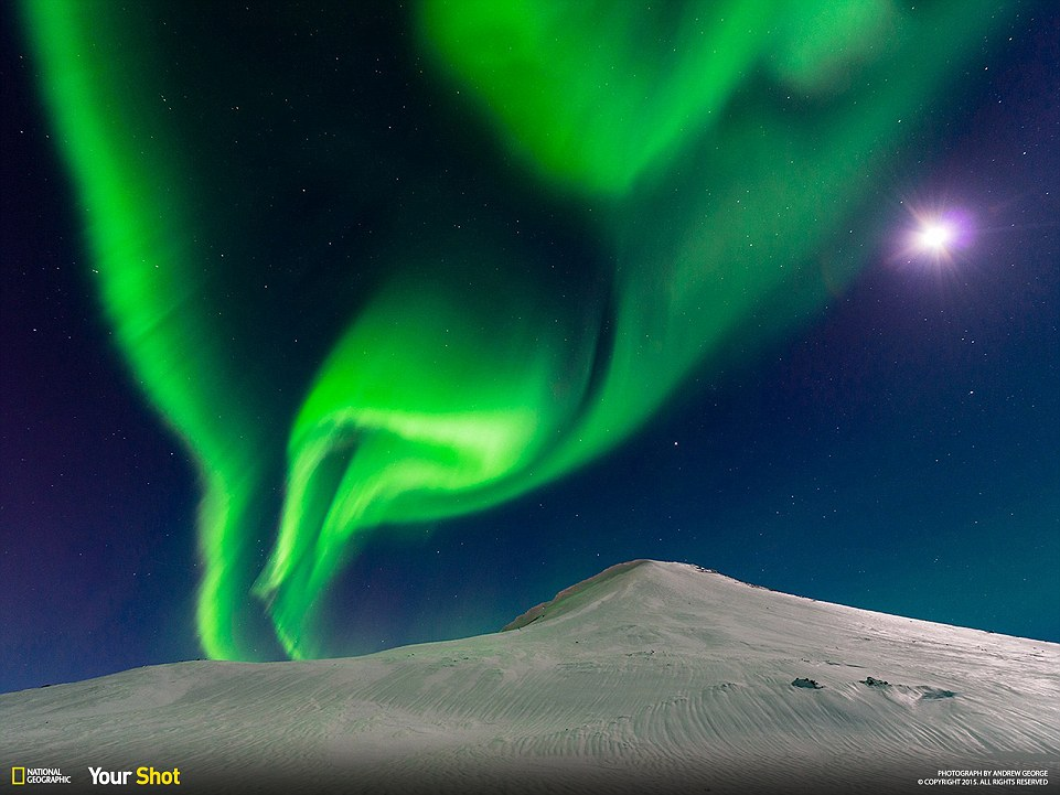 Last night's aurora borealis in Iceland with moonlight.